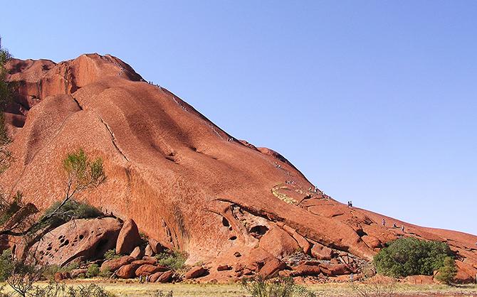 "IMAGE: ""Ayers Rock - Kuniya walk (Rock climbing)"". Licensed under Public domain via Wikimedia Commons"
