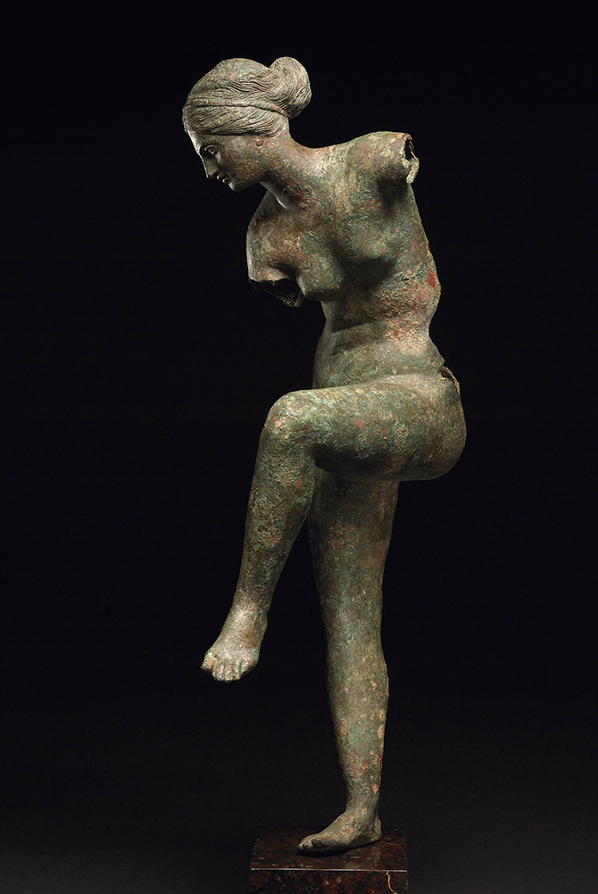 < Bronze Figure of Aphrodite (200-100 BC), said to be from near Patras, (without base) 55.5 (h) x 26 (w) x 15.5 (d) cm.