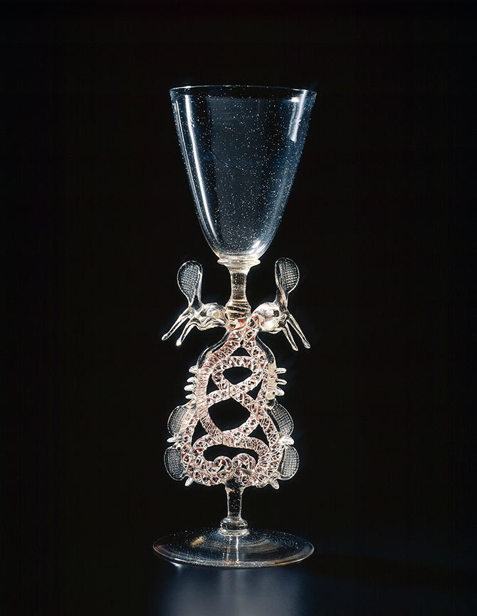 < The Netherlands, Holland/Germany, Serpent-stem goblet, (Flügelglas), (early 17th century), glass (façon de Venise), red and white threads, applied and pincered decoration, 28.3 x 10 cm (diameter), National Gallery of Victoria, Melbourne. Felton Bequest, 1977