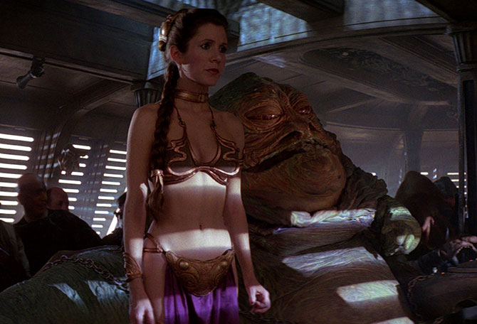 "Leia watches the ""execution"" waiting for the signal to make her escape. Source: Wookieepedia - Star Wars: Episode VI Return of the Jedi. This is a screenshot of a copyrighted movie that may be exhibited in the fair use provision of United States copyright law."