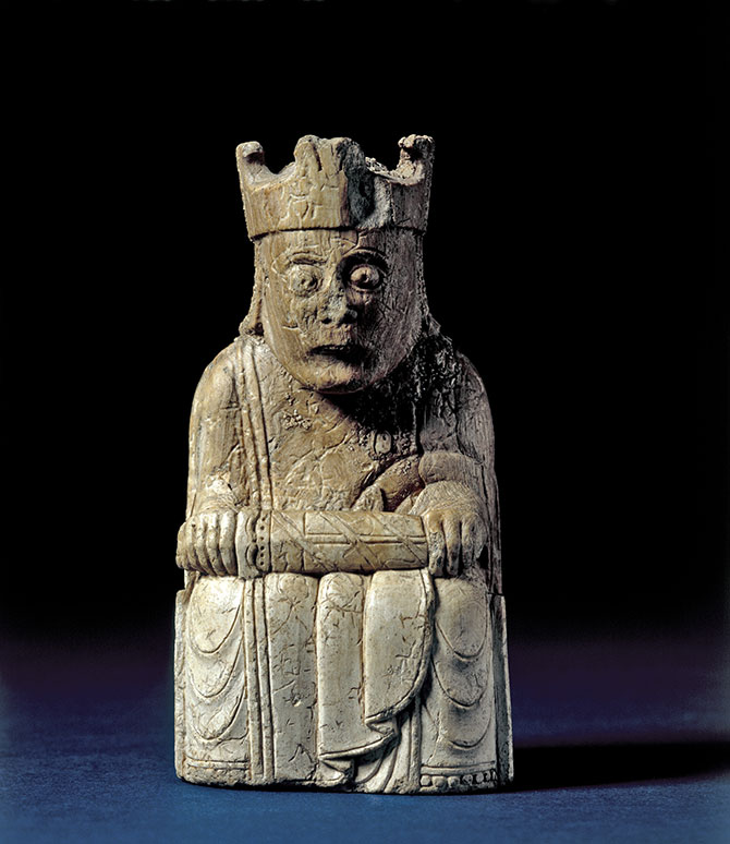 Unknown (found in Scotland), Lewis Chess King (1150-1200), walrus ivory; king with sword with baldric wound around, guard decorated; damaged crown; back of throne decorated with animal heads at top of uprights framing leaf-scrolls in symmetrical composition, 9.5 x 4.7 x 3.6 cm.