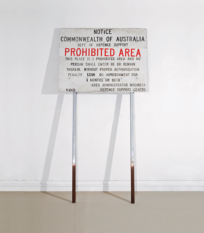 Adam NORTON, Prohibited Area 2010, acrylic paint on board, wooden poles and bolts, 240 x 122x 7 cm. Copyright: the artist.