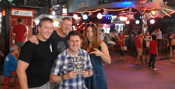 More avid readers on Bangla Road, photo by Roxy Cameron.