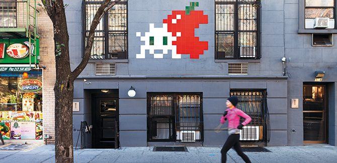 Artist: Invader (NYC_176) Photo: Invader. 322 West 14th Street, New York, USA. Reproduced with permission from Street Art, © 2017 Lonely Planet